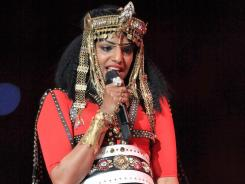 Bad Girl M.I.A. throws a middle finger to Super Bowl audience.